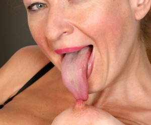 Horny old slut Ivana Slew licking her hard nipple and toying her mature pussy