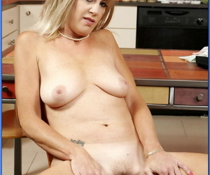 Matured teacher with big tits Liz Summers strips nude coupled with masturbates