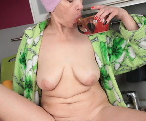 Mature housewife Karolina wets her natural bush with morning cup of in kitchen