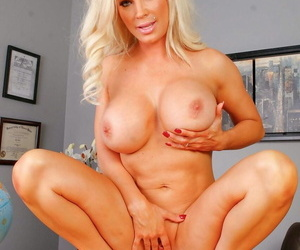 Chubby titted blonde Principal Diamond Foxxx strips naked in her place