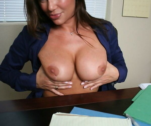 Middle-aged female school principal Sky Taylor masturbates in her office