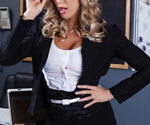 Busty teacher Brandi Love shows her big tits while wearing black stockings
