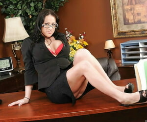 Flirtatious MILF penman Moxxie Maddron stripping nude in the office