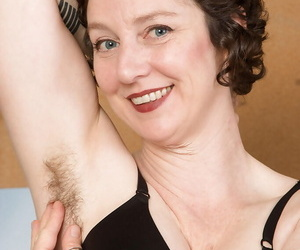 Older secretary Artimesia brief hairy underarms and pussy with respect to office