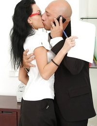 Alluring secretary in stockings brings her asshole into play with her boss