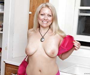 Mature blonde MILF Zoey Tyler undressing for shaved pussy spreading