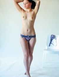 Teen solo girl Inky removes lingerie set for great nude poses