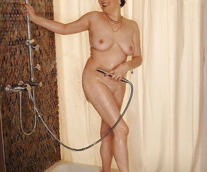 Sexy mature brunette stripping stay away from her lingerie added to pulling a shower