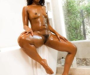 Naked ebony dime Rachel RoXXX letting shower spray run over hairy vagina