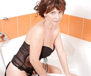 Mature lassie in lingerie gets in the cleanly near dissimulation helter-skelter her sex toys