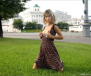 Pretty blonde flashes naked upskirt in a field small nude tits in the city