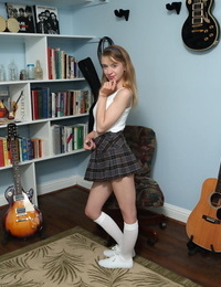 Young looking girl Kristy May toys her pussy in white knee socks and sneakers