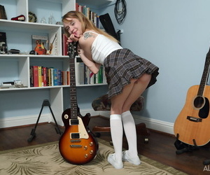 Young expecting cookie Kristy May toys her pussy in lifeless knee socks increased by sneakers