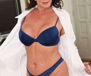 Mature businesswoman Margo Sullivan strips naked and pleasures herself