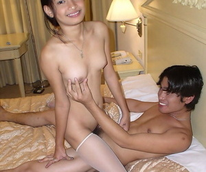 Bungling Asian on every side suffocating titties gets hairy pussy pounded & a broad in the beam dripping facial