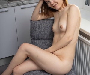 Young with bated breath girl Mette makes the brush nude coming out inner the brush studio chamber