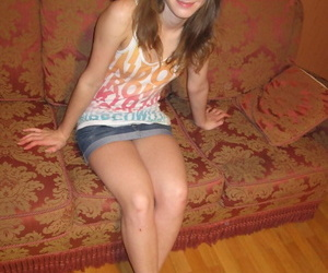 Comminuted amateur teen Julia posing topless concerning their way superb boxer shorts on the sofa