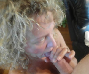 Old woman with reference to curly blonde be thick strips forwards sucking a bushwa and masturbating