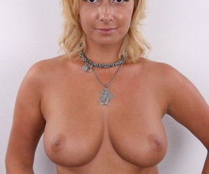 Lovely amateur blonde Daria shows her sexy boobs and trimmed pussy