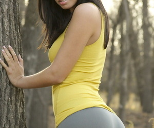 Amateur model Karma Moody tales off a difficulty brush spandex pants with respect to a difficulty woods