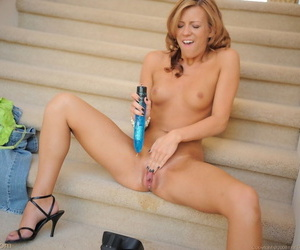 Small titted skinny Leslie poses & masturbates with dildo on a public stairway