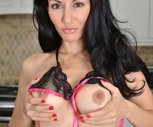 Skinny MILF Olivia Bell shows off her round tits & sweet pussy in the kitchen
