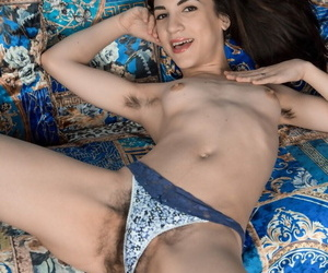 Flat chested amateur Luna O on her back spreading her hairy pussy wide open