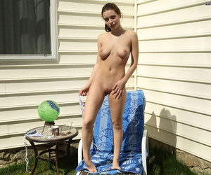 Kinky amateur Lana Rhoades stretches her tight vagina in the back yard