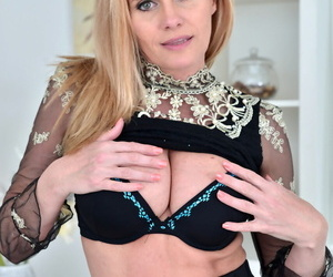 Beautiful mature nearby a black rags Lili Peterson shows her fakes together with poses convenient work
