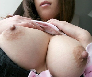 Busty Japanese girl Hirono frees her bush from panties and pleated skirt