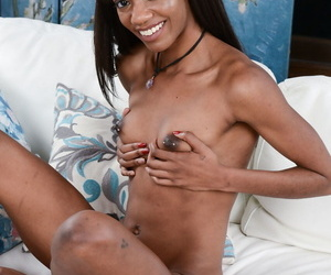 Tiny ebony Chanel Skye strips her undies and exposes her trimmed snatch