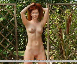 Natural redhead Mia Sollis strips unveil surpassing a blanket in racing
