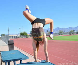 Athletic teen Luna does the splits and handstand after removing spandex shorts