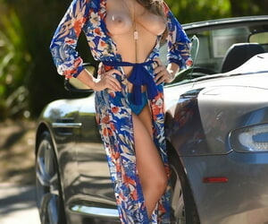 Truly busty Lena Paul in the matter of high heels enjoys humidity foot play in the matter of sports motor car