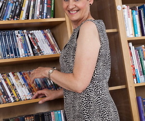 Adult librarian Dee shows the brush pithy natural bowels & shaved pussy relating to stockings