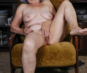 Saggy boobed granny Nina takes their way clothes off and toys their way unshaved beaver