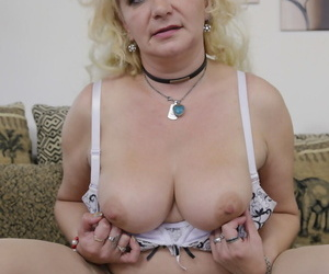 Bosomy granny strips yon their way stockings before toying and fingering their way pussy