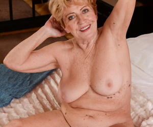 Close-up shots be fitting of blond fat granny Malya painless she plays concerning her pussy