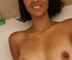 Skinny coddle with big jugs Sonya N shows her hairy crotch in a bathtub