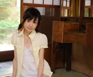 Hidden Japanese girl Aoba Itou models non nude in satin underclothes