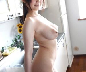 Stunning Japanese wife Rie Tachikawa exposes her big juggs before hard sex
