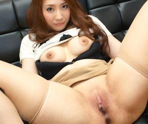 Japanese redhead Akari Niiyama showcases her shaved vagina in sheer nylons