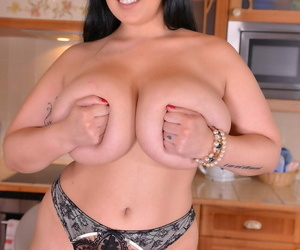 Busty housewife Anastasia Lux plays with her boobs before toying herself