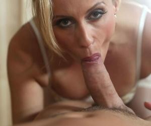 Blonde MILF masseuse Brittany Bardot sucks her clients cock & bangs him