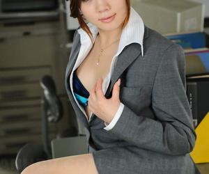 Beautiful Japanese businesswoman Iroha Kawashima exposes her brassiere at work