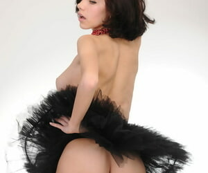 Pizazz model Elsa A strikes fine nude poses on every side a tutu and fishnets