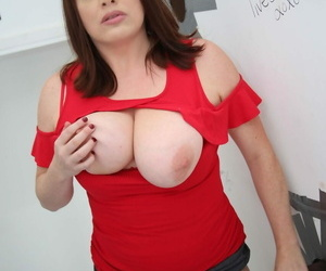 Horny cougar Maggie Green shows her big boobs and sucks a gloryhole BBC