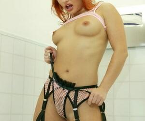 Top pornstar Katja Kassin sucks cock via a bathroom gloryhole