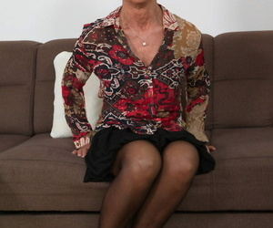 Short haired granny Romana strips roughly the brush stockings increased by toys the brush mature pussy
