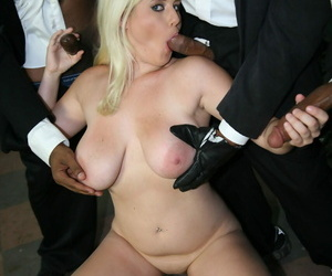 Blonde Cindee sucks some black guys dicks before they cum on her face